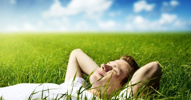 man_relaxing_field_sun_calm_peaceful
